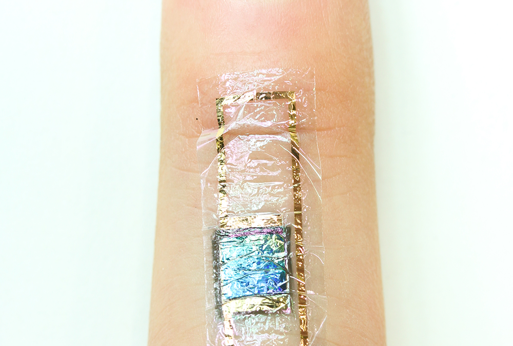 A self-powered heart monitor taped to the skin